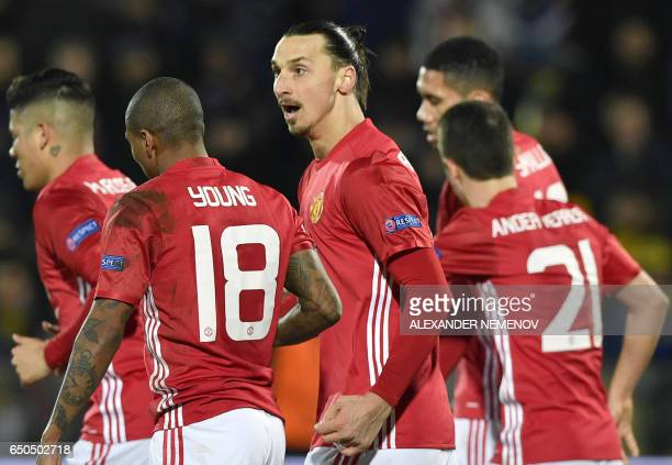 Manchester United's Swedish forward Zlatan Ibrahimovic celebrates with teammates after scoring a goal during the UEFA Europa League round of 16...