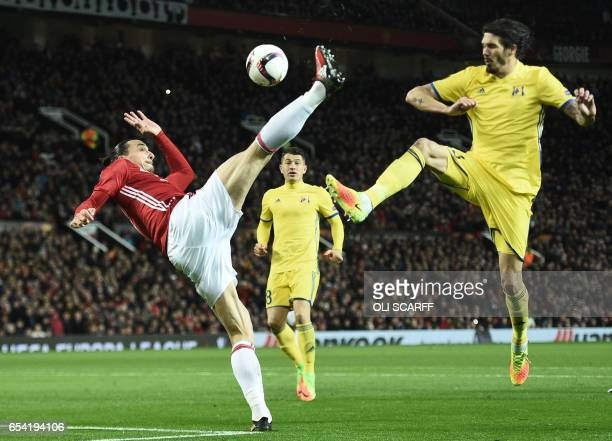 TOPSHOT Manchester United's Swedish striker Zlatan Ibrahimovic acrobatically crosses the ball during the UEFA Europa League round of 16 secondleg...