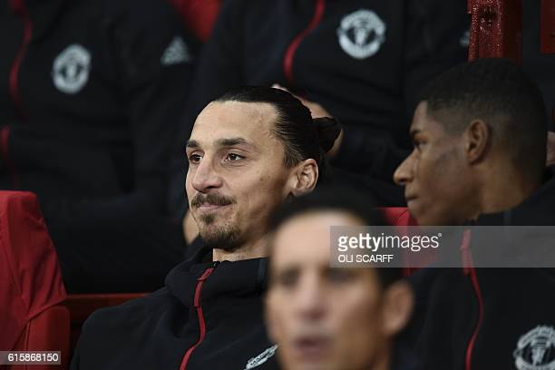 Manchester United's Swedish striker Zlatan Ibrahimovic and Manchester United's English striker Marcus Rashford sit on the substitutes bench ahead of...