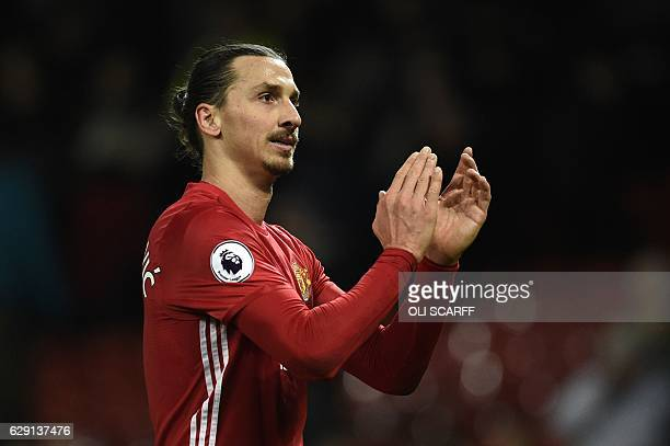 Manchester United's Swedish striker Zlatan Ibrahimovic applauds supporters as he walks from the pitch after the English Premier League football match...