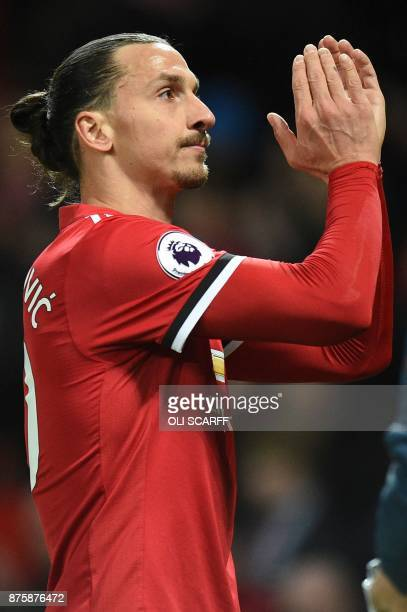 Manchester United's Swedish striker Zlatan Ibrahimovic applauds as he leaves the pitch at the end of the English Premier League football match...