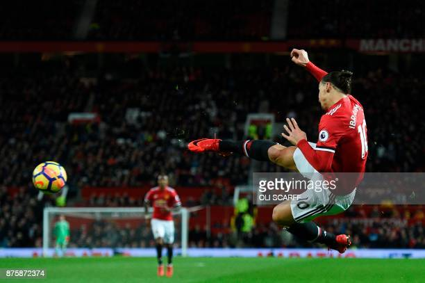 Manchester United's Swedish striker Zlatan Ibrahimovic attempts a bicycle kick shot which was saved during the English Premier League football match...