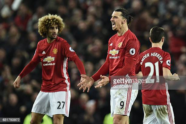 Manchester United's Swedish striker Zlatan Ibrahimovic celebrates scoring his team's first goal with Manchester United's Belgian midfielder Marouane...