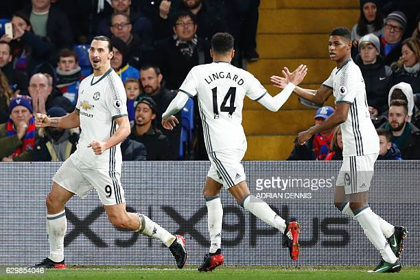 Manchester United's Swedish striker Zlatan Ibrahimovic celebrates scoring their second goal with Manchester United's English midfielder Jesse Lingard...
