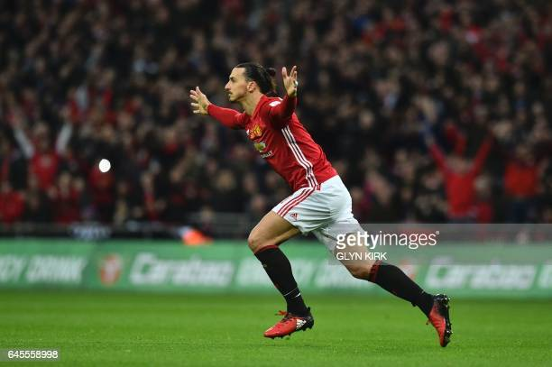 Manchester United's Swedish striker Zlatan Ibrahimovic celebrates scoring the opening goal from a free kick during the English League Cup final...