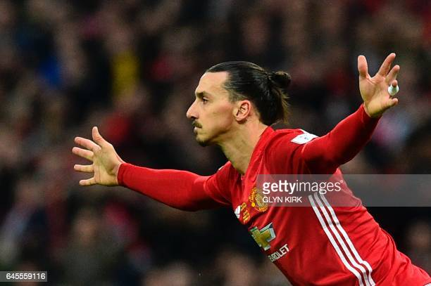 TOPSHOT Manchester United's Swedish striker Zlatan Ibrahimovic celebrates scoring the opening goal from a free kick during the English League Cup...