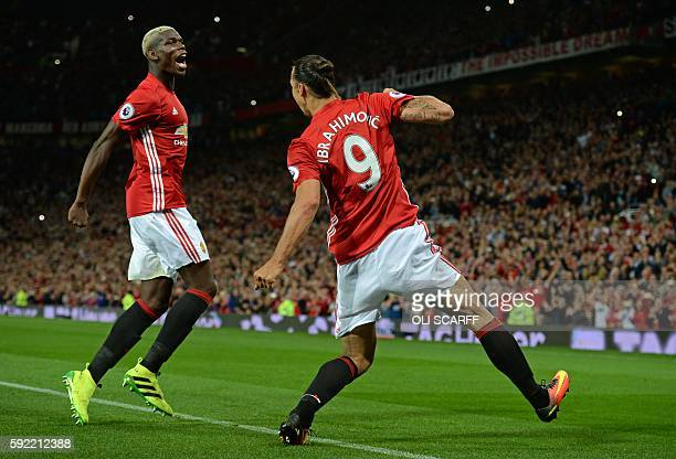 Manchester United's Swedish striker Zlatan Ibrahimovic celebrates with Manchester United's French midfielder Paul Pogba after scoring their second...