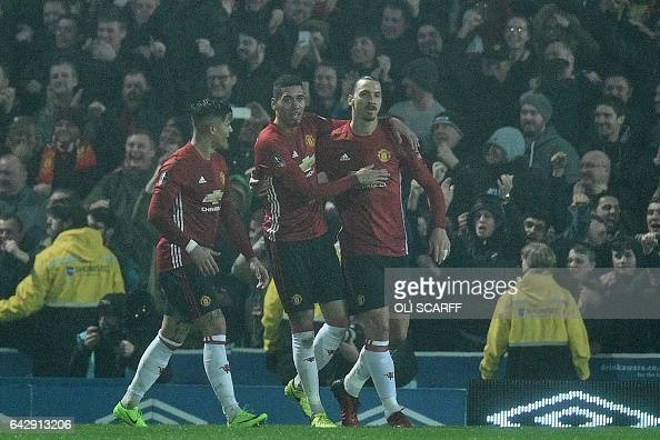 Manchester United's Swedish striker Zlatan Ibrahimovic celebrates with teammates after scoring their second goal during the English FA Cup fifth...