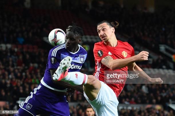 Manchester United's Swedish striker Zlatan Ibrahimovic challenges Anderlecht's Senegalese defender Mbodj Kara for a header during the UEFA Europa...