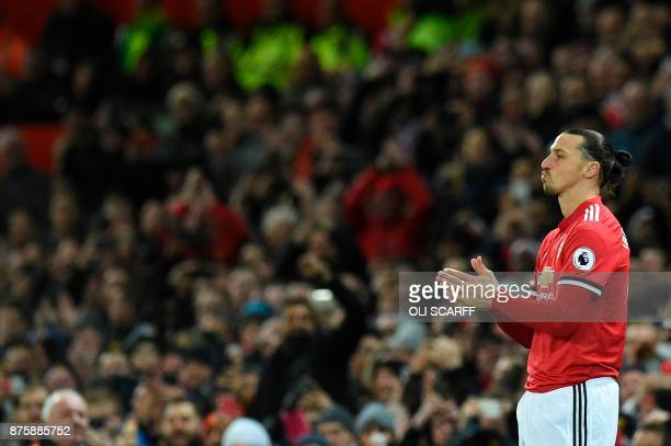 Manchester United's Swedish striker Zlatan Ibrahimovic gestures on the touchline as he comes on as a substitute during the English Premier League...