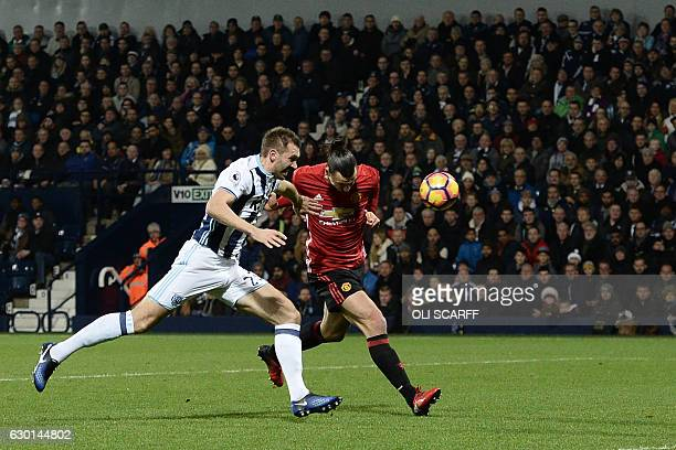 Manchester United's Swedish striker Zlatan Ibrahimovic gets behind West Bromwich Albion's Northern Irish defender Gareth McAuley to score the opening...