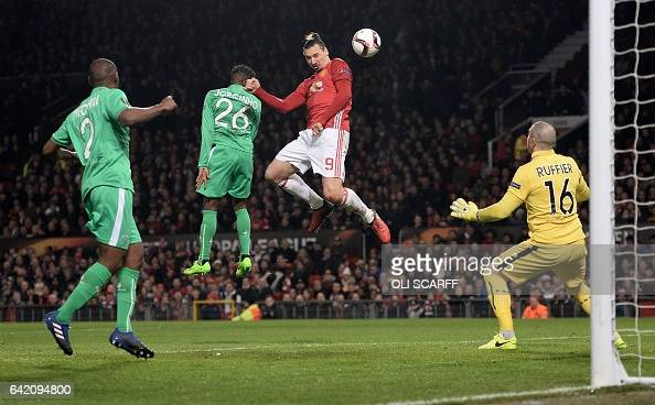TOPSHOT Manchester United's Swedish striker Zlatan Ibrahimovic heads the ball to score but is ruled offside during the UEFA Europa League Round of 32...