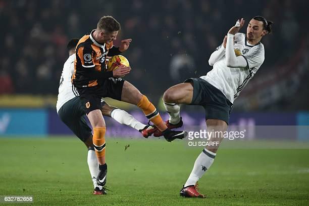 Manchester United's Swedish striker Zlatan Ibrahimovic is blocked by Hull City's English defender Josh Tymon during the EFL Cup semifinal secondleg...