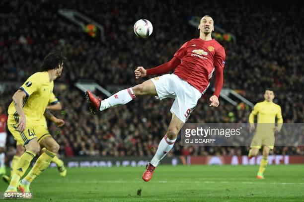 Manchester United's Swedish striker Zlatan Ibrahimovic jumps for the ball during the UEFA Europa League round of 16 secondleg football match between...
