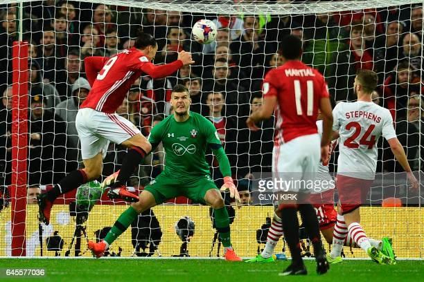 TOPSHOT Manchester United's Swedish striker Zlatan Ibrahimovic jumps to head their third goal past Southampton's English goalkeeper Fraser Forster...