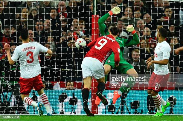 Manchester United's Swedish striker Zlatan Ibrahimovic jumps to head their third goal past Southampton's English goalkeeper Fraser Forster during the...