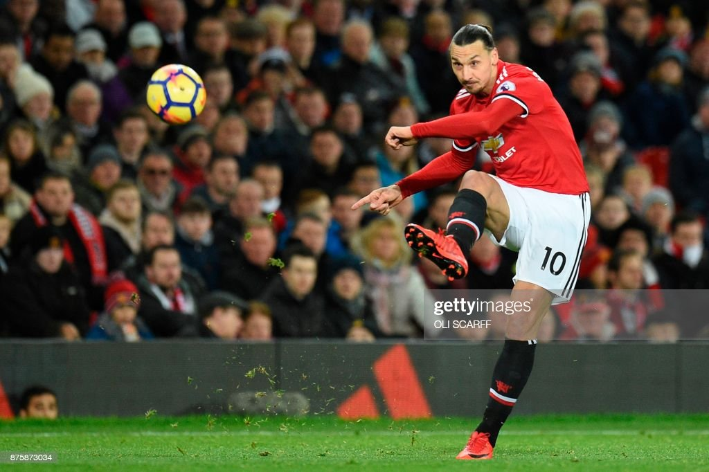 TOPSHOT - Manchester United's Swedish striker Zlatan Ibrahimovic plays the ball during the English Premier League football match between Manchester United and Newcastle at Old Trafford in Manchester, north west England, on November 18, 2017. / AFP PHOTO / Oli SCARFF / RESTRICTED TO EDITORIAL USE. No use with unauthorized audio, video, data, fixture lists, club/league logos or 'live' services. Online in-match use limited to 75 images, no video emulation. No use in betting, games or single club/league/player publications. /