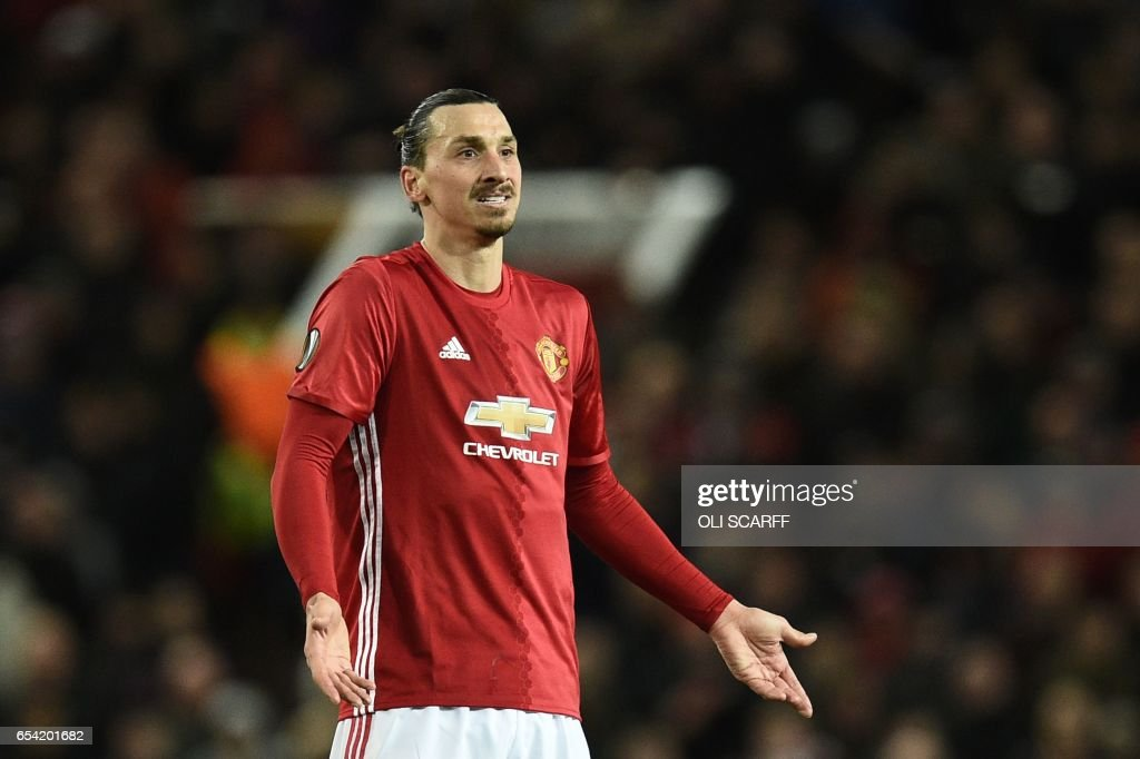 TOPSHOT - Manchester United's Swedish striker Zlatan Ibrahimovic reacts during the UEFA Europa League round of 16 second-leg football match between Manchester United and FC Rostov at Old Trafford stadium in Manchester, north-west England, on March 16, 2017. / AFP PHOTO / Oli SCARFF
