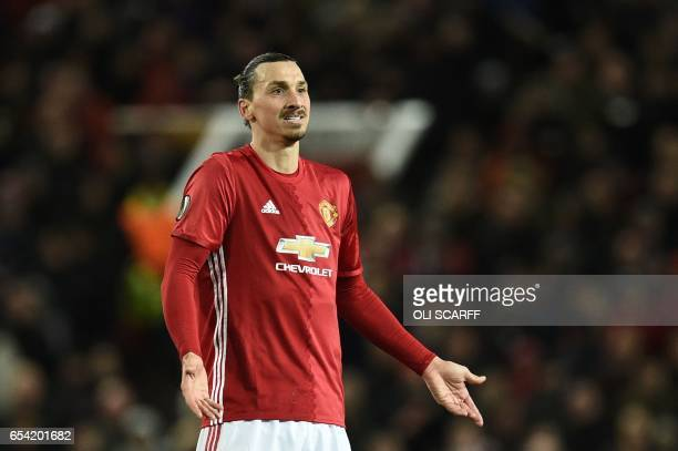 TOPSHOT Manchester United's Swedish striker Zlatan Ibrahimovic reacts during the UEFA Europa League round of 16 secondleg football match between...