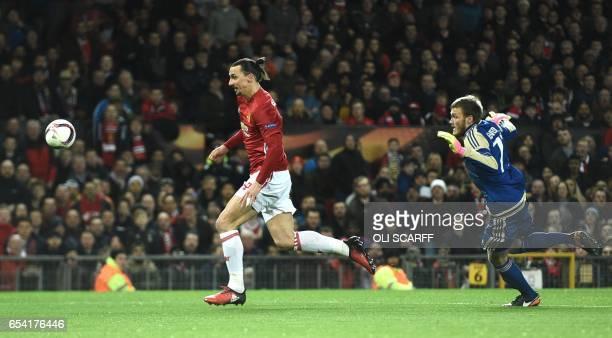 Manchester United's Swedish striker Zlatan Ibrahimovic rounds Rostov's Russian goalkeeper Nikita Medvedev during the UEFA Europa League round of 16...