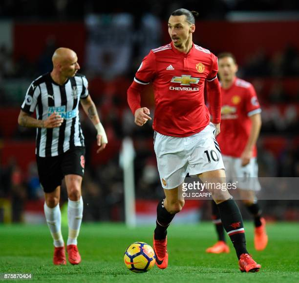 Manchester United's Swedish striker Zlatan Ibrahimovic runs with the ball during the English Premier League football match between Manchester United...