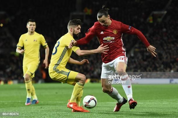 Manchester United's Swedish striker Zlatan Ibrahimovic takes on Rostov's Slovanian defender Miha Mevlja during the UEFA Europa League round of 16...