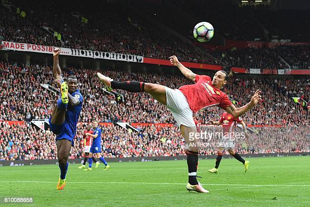 Manchester United's Swedish striker Zlatan Ibrahimovic tries to reach a driven cross during the English Premier League football match between...