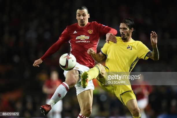 Manchester United's Swedish striker Zlatan Ibrahimovic vies with Rostov's Spanish defender Cesar Navas during the UEFA Europa League round of 16...