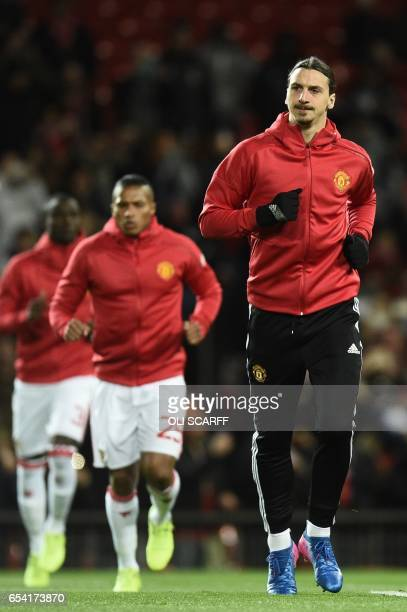 Manchester United's Swedish striker Zlatan Ibrahimovic warms up for the UEFA Europa League round of 16 secondleg football match between Manchester...