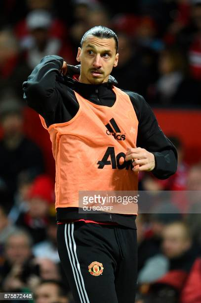 Manchester United's Swedish striker Zlatan Ibrahimovic warms up on the touchline during the English Premier League football match between Manchester...