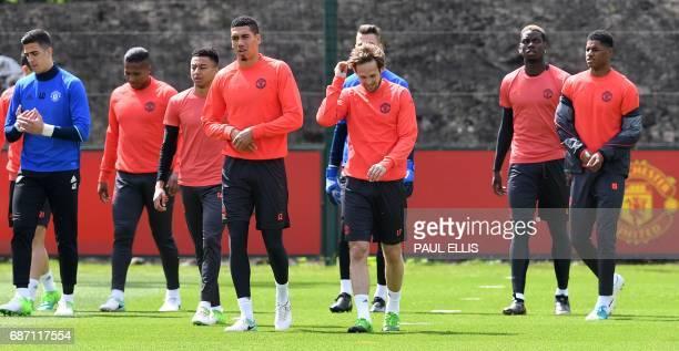 Manchester United's Swiss goalkeeper Joel Castro Pereira Manchester United's Ecuadorian midfielder Antonio Valencia Manchester United's English...