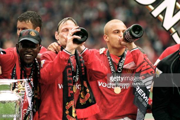 Manchester United's Teddy Sheringham and Wes Brown toast another FA Carling Premiership title with bottles of champagne