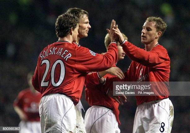 LEAGUE Manchester United's Teddy Sheringham celebrates scoring the second goal with Nicky Butt and Ole Gunnar Solskjaer against SK Sturm Graz during...