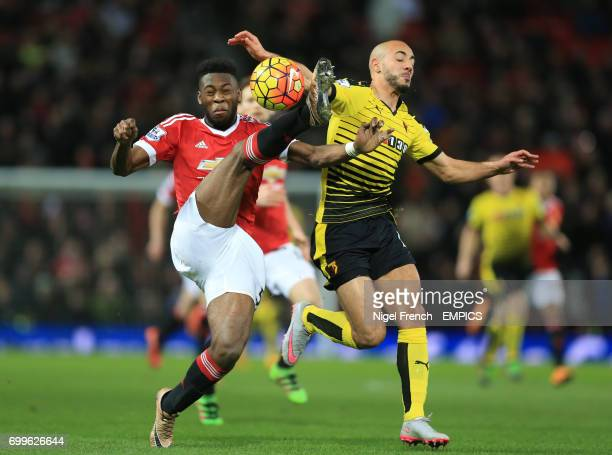 Manchester United's Tim FosuMensah and Watford's Nordin Amrabat battle for the ball