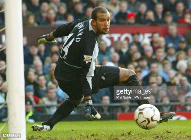 Manchester United's Tim Howard dives for the ball against Manchester City during the Barclaycard Premiership match at Old Trafford Manchester...