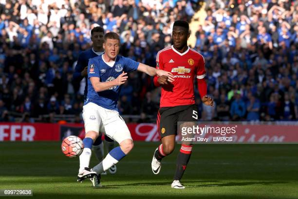 Manchester United's Timothy FosuMensah and Everton's James McCarthy battle for the ball