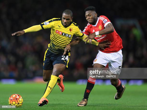 Manchester United's Timothy FosuMensah and Watford's Odion Ighalo