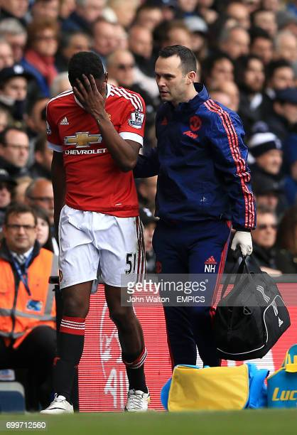 Manchester United's Timothy FosuMensah leaves the field with an injury in the second half