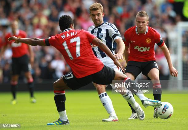 Manchester United's Tom Cleverley and Luis Nani battle for the ball with West Bromwich Albion's James Morrison