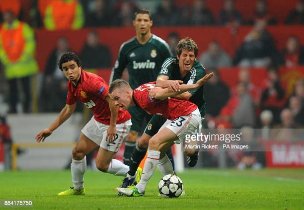 Manchester United's Tom Cleverley and Real Madrid's Alexandre Fabio Coentrao battle for the ball