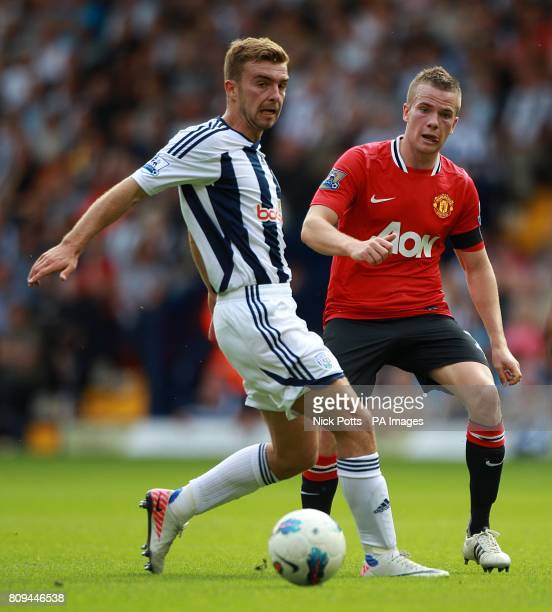 Manchester United's Tom Cleverley and West Bromwich Albion's James Morrison