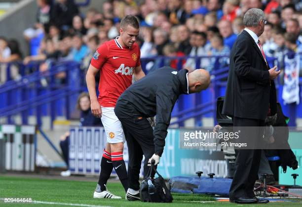 Manchester United's Tom Cleverley leaves the pitch with an injury during the Barclays Premier League match at the Reebok Stadium Bolton
