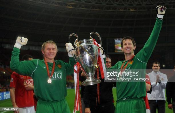 Manchester United's Tomasz Kuszczak and Edwin Van Der Sar celebrate with the trophy following the UEFA Champions League Final at the Luzhniki Stadium...