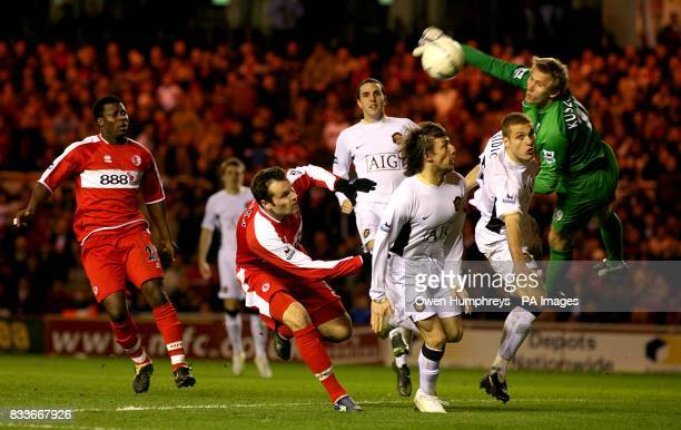Manchester United's Tomasz Kuszczak comes out of his goal for a cross