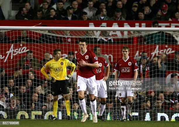 Manchester United's Tomasz Kuszczak Michael Carrick and Darren Fletcher prepare for the restart following an equalising goal by Reading's Brynjar...