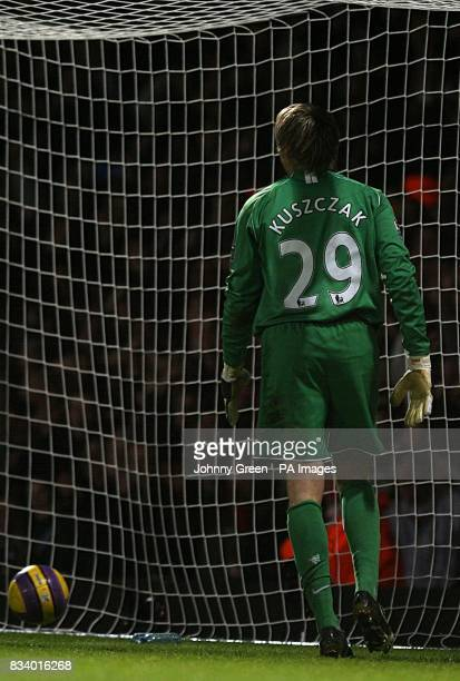 Manchester United's Tomasz Kuszczak stands dejected after West Ham United's Matthew Upson scores their second goal