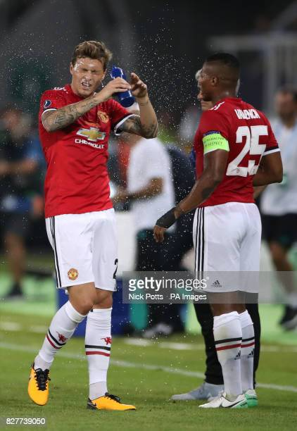 Manchester United's Victor Lindelof and Manchester United's Antonio Valencia during the first half water break during the UEFA Super Cup match at the...