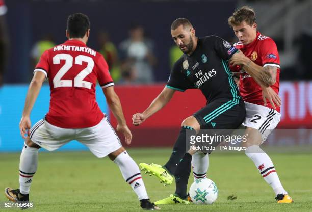 Manchester United's Victor Lindelof and Real Madrid's Karim Benzema battle for the ball during the UEFA Super Cup match at the Philip II Arena Skopje...