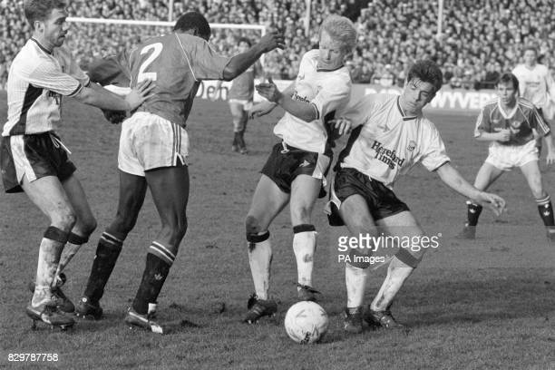 Manchester United's Viv Anderson is outnumbered by Hereford United's Colin Robinson Paul Tester and Steve Devine