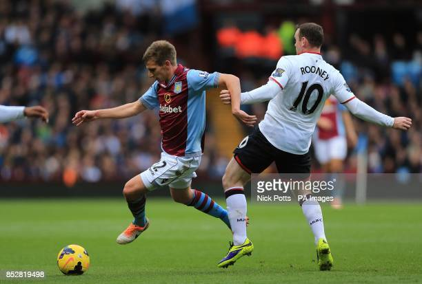 Manchester United's Wayne Rooney and Aston Villa's Marc Albrighton battle for the ball